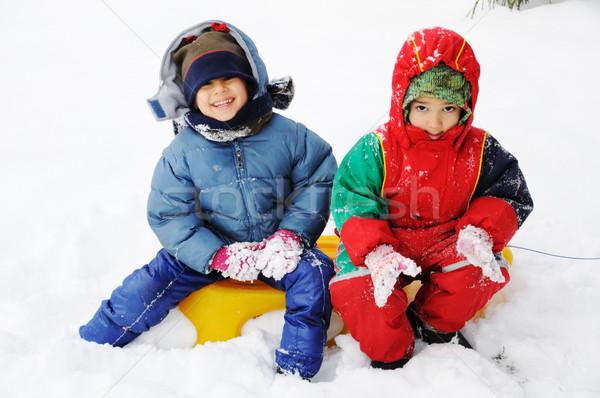 Happy children in snow  Stock photo © zurijeta