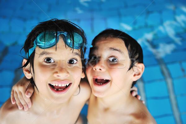 Kinderen activiteiten zwembad glimlach liefde gelukkig Stockfoto © zurijeta