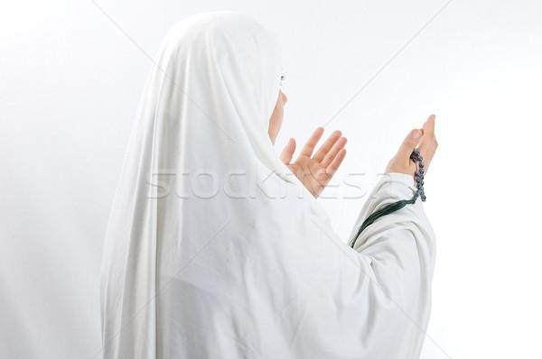 Veiled woman praying Stock photo © zurijeta