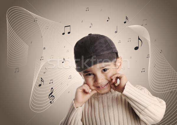 Musical boy with denim cap Stock photo © zurijeta