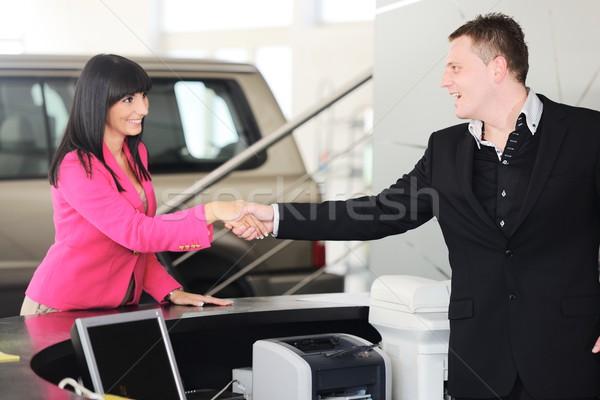 Man handing woman automobile keys for the new car Stock photo © zurijeta