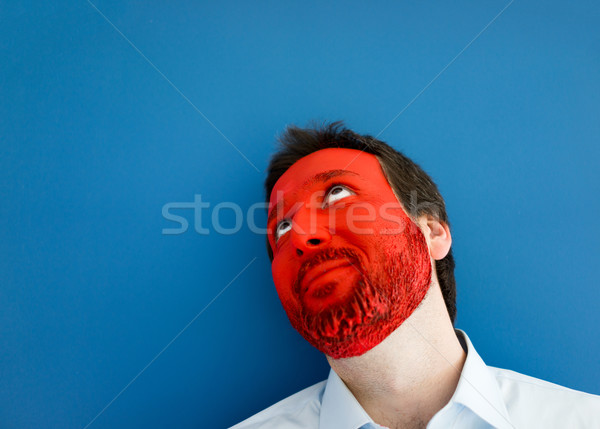 Portrait of adult business man with colorful painted face Stock photo © zurijeta