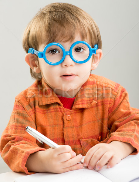 Adorable baby learning and getting ready for school in kindergar Stock photo © zurijeta