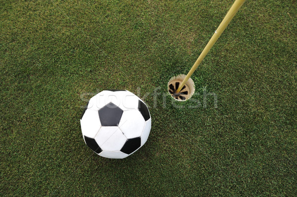 Football big ball at golf field hole Stock photo © zurijeta
