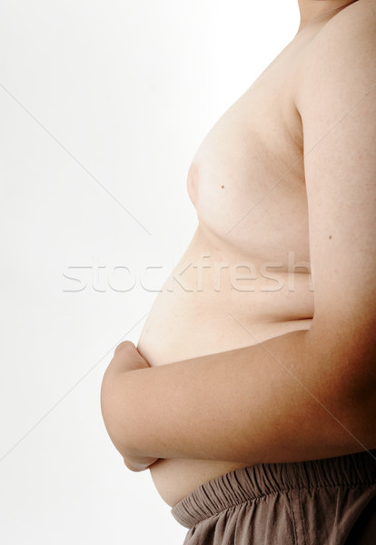 Fat boy, hand on stomach Stock photo © zurijeta