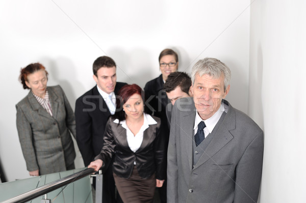 Business people ascending office stairs towards camera Stock photo © zurijeta
