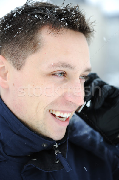 Young male adult speaking on phone at winter snow time Stock photo © zurijeta
