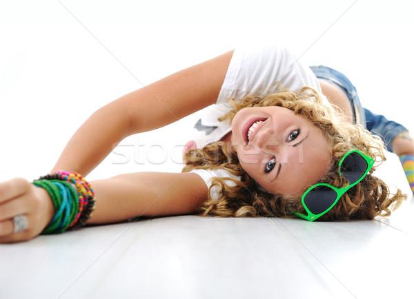 Genç sevimli kız kıvırcık saçlı zemin gülümseme Stok fotoğraf © zurijeta