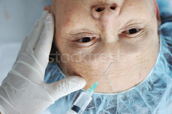 Senior woman getting botox injection at hospital Stock photo © zurijeta