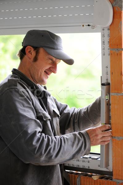 Construction man using level tool Stock photo © zurijeta