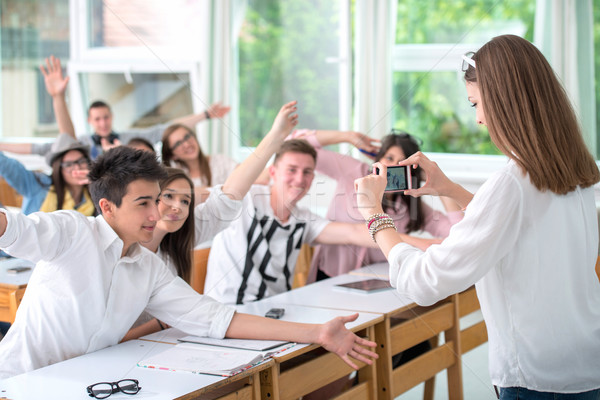 Girl taking a picture of classroom Stock photo © zurijeta