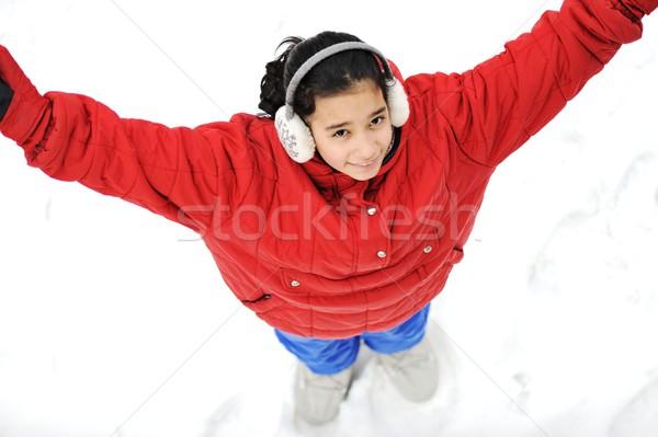 Kids girls sitting in snow Stock photo © zurijeta
