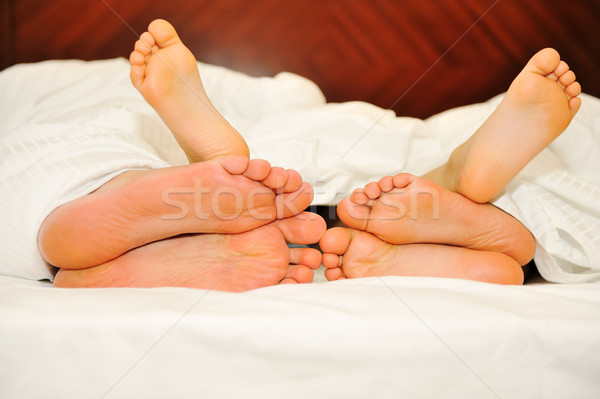 Happy family in bed, six feet Stock photo © zurijeta