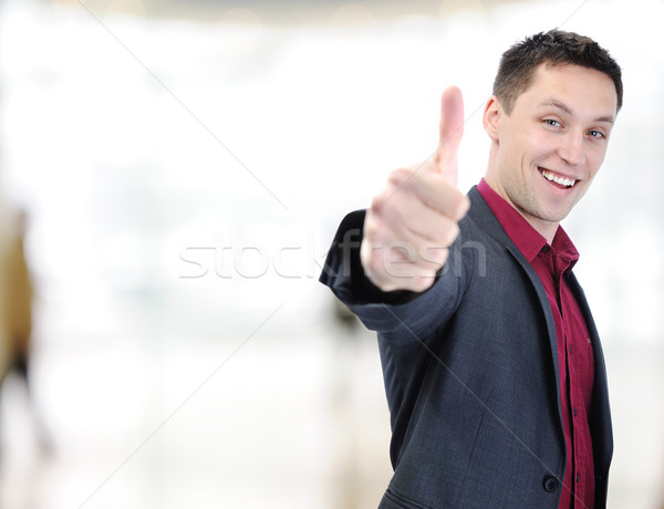 Young caucasian man  showing thumbs up Stock photo © zurijeta