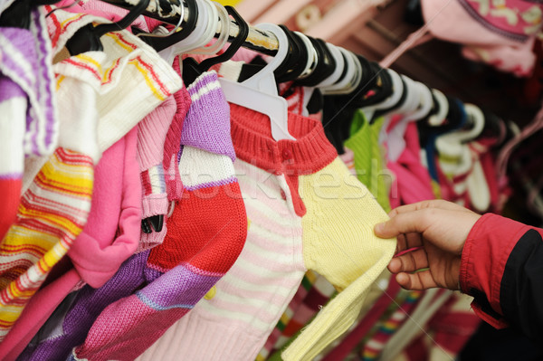 Close-up of a female  customer looking for children clothes in a fashion store Stock photo © zurijeta