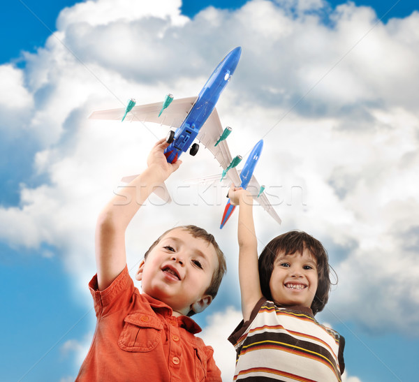 Two small boys with airplains in hands, idea for traveling around the World Stock photo © zurijeta