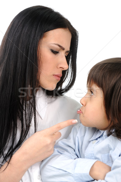 Boy confronts his mother who is threatening him Stock photo © zurijeta