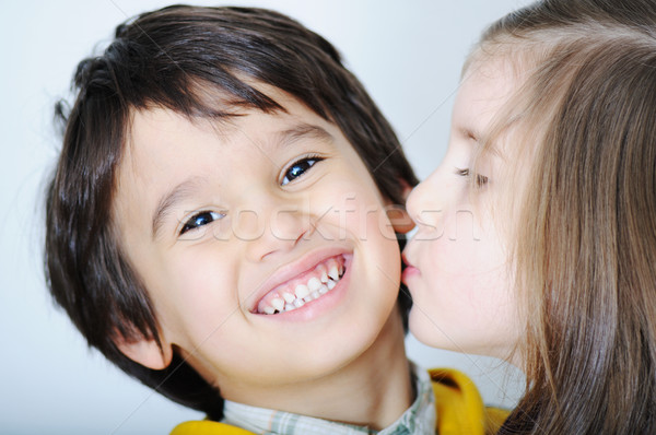 Adorable toddler girl kissing her brother Stock photo © zurijeta