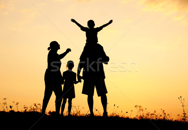 Happy family in nature at sunset Stock photo © zurijeta