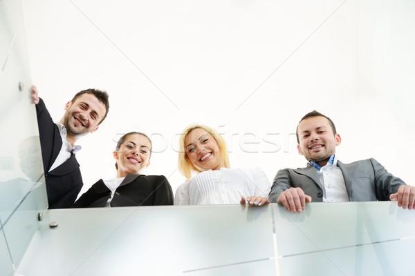 Successful business people on railing Stock photo © zurijeta