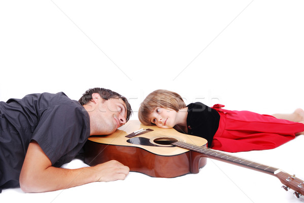 Happy father and daughter lie on guitar Stock photo © zurijeta