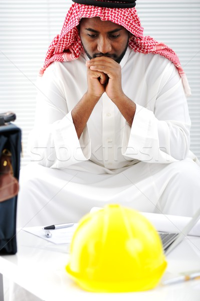 Arabic engineer having a concern about the plans Stock photo © zurijeta