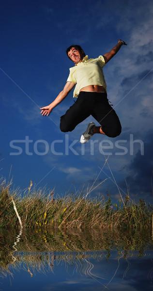 Young active man jumping, darkness Stock photo © zurijeta