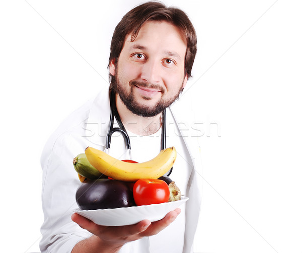 Young male doctor advicing healthy natural food Stock photo © zurijeta