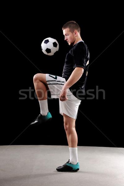Soccer player doing tricks with ball Stock photo © zurijeta