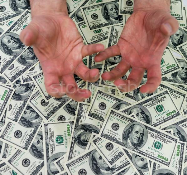 Dollaro mani uomo verde banca successo Foto d'archivio © zurijeta