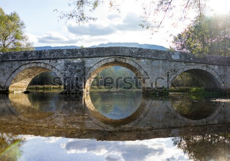 Group of people on old bridge holding arms up for success Stock photo © zurijeta