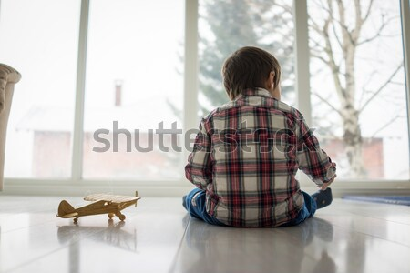 Sad kid sitting on floor Stock photo © zurijeta