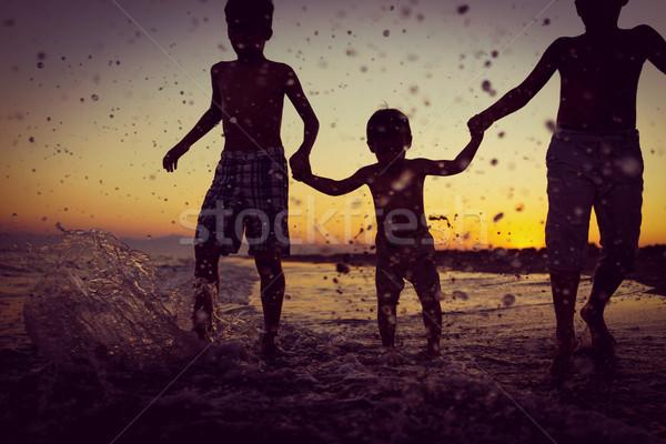 Fun kids playing splash at beach Stock photo © zurijeta