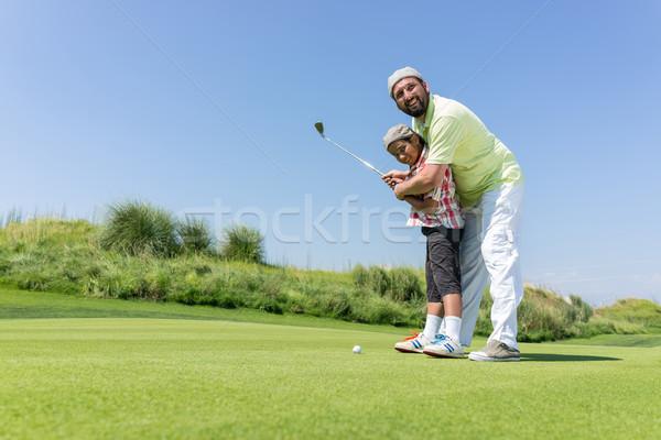 Padre insegnamento figlio giocare golf club Foto d'archivio © zurijeta