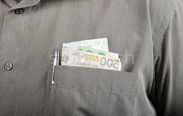 Currency, one hundred euro in shirt pocket of male Stock photo © zurijeta