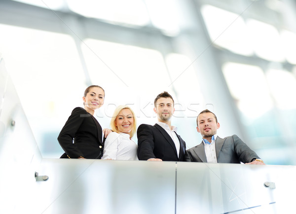 Successful business people on railing Stock photo © zurijeta