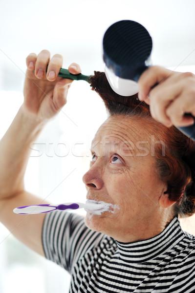Idős nő haj ventillátor fogmosás idős Stock fotó © zurijeta