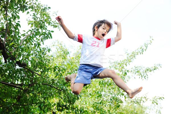 ジャンプ 子供 空気 空 子供 背景 ストックフォト © zurijeta