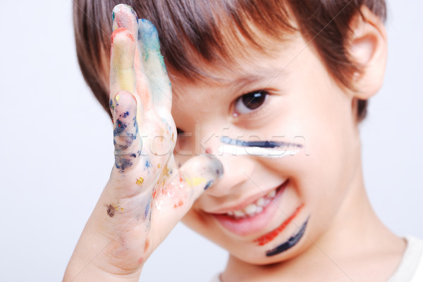 Little cute kid with colors on his face Stock photo © zurijeta