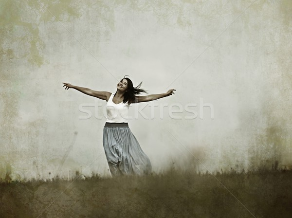 Filtered image of a person having relaxed happy time on meadow i Stock photo © zurijeta