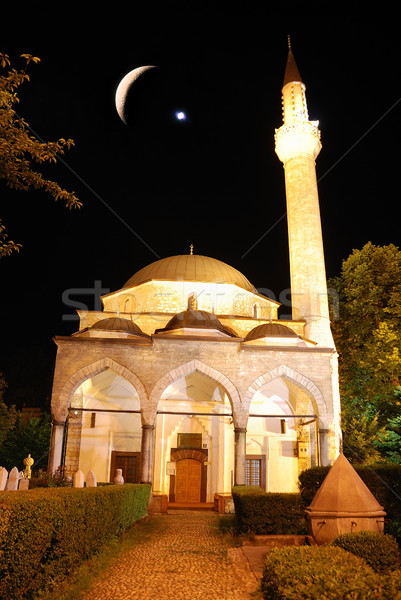 Mosque in night with crescent and star above Stock photo © zurijeta