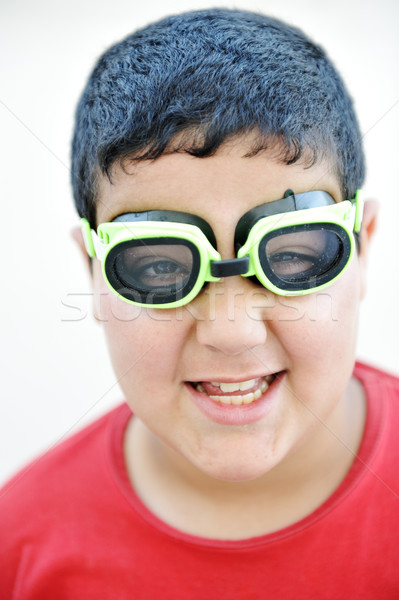 Happy funny cute  boy with the pool swimming goggles Stock photo © zurijeta