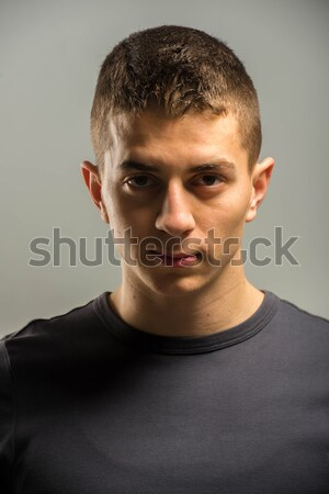 Young man short hair in white t-shirt portrait Stock photo © zurijeta