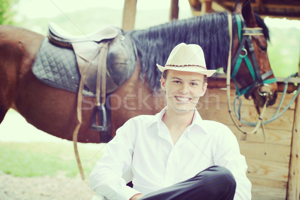 Happy young people on countryside with horse for riding Stock photo © zurijeta