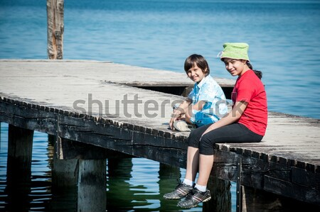 Menina caminhada lago doca céu sorrir Foto stock © zurijeta