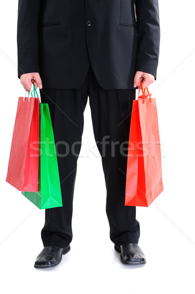Legs of a businessman holding shopping bags Stock photo © zurijeta