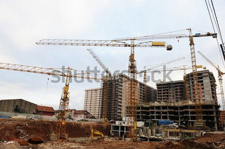 Site buildings under construction and cranes Stock photo © zurijeta
