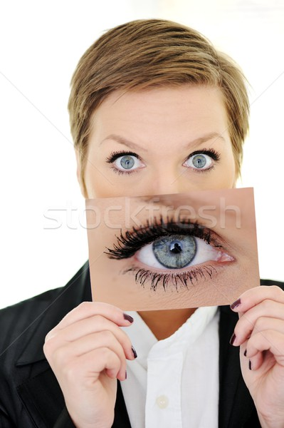 Stock photo: Girl portrait holding card with big eye concept