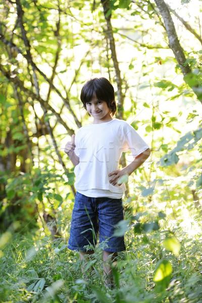 Kid standing in nature Stock photo © zurijeta