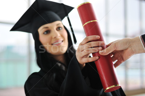 Young female graduating and receiving diploma at university Stock photo © zurijeta